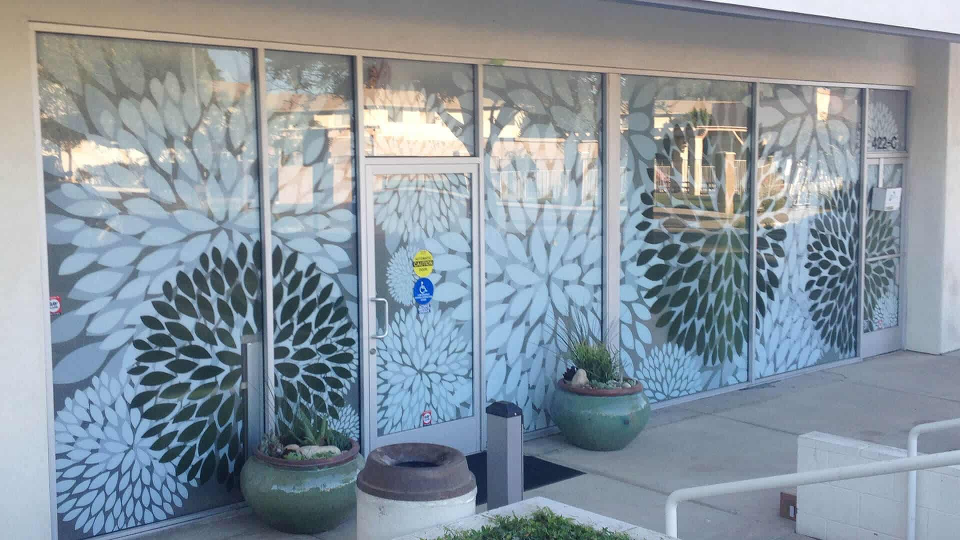 Photo of Arneill's Woman's Center Plate Glass Mums print on exterior windows by DIG53